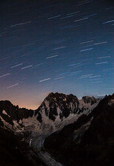 Stars over Grandes Jorasses (Ulrik Hasemann) Tags: light sky france night canon dark stars exposure outdoor glacier climbing alpine environment activity dslr chamonix climbers startrails 5dii