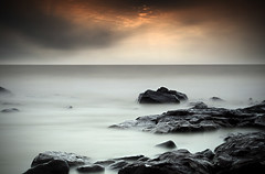 The Last Shot (Sal Virji (Sal's Marine) on / off) Tags: ocean longexposure sunset clouds rocks filter bandstand filters cloudscapes arabiansea goldensky 400d 10stopfilter bw10stop singrayfilter salsmarine 24mmto105mmlisusm bigstopper longexposure salvirji indiaseascape mumbaiseascape