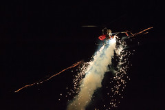 Roger Buis in Otto the Helicopter (Norman Graf) Tags: fireworks aircraft smoke airshow helicopter hughes aerobatics rotorcraft nightshow kntu ourflagwasstillthere rotarywingaircraft 269c rogerbuis apollosoucekfield ottothehelicopter n7505b nasoceanaairshow2012
