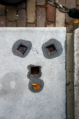 fixing a hole (maartje jaquet) Tags: face amsterdam stone hole song explore fixing keizersgracht thebeatles foundsculpture explored stadstuincitygarden