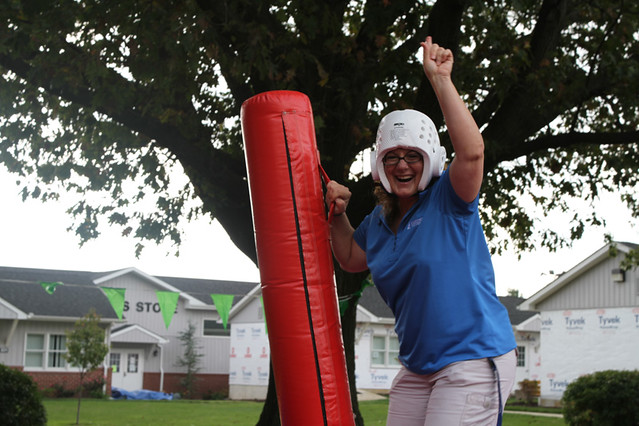 Karen Sheats conquers her opponent in inflatable jousting.  Way to go, Karen!