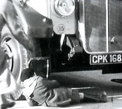 Allow a responsible adult to come to your rescue (theirhistory) Tags: road street boy england bus fall hat wheel scarf death 1930s kid coach child accident coat guard injury vehicle