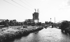 building up, wearing down (almostsummersky) Tags: path overgrown building bridge water brush powerlines trees summer construction river monochromatic southplatteriver colorado blackwhite ripples denver frame travel waves unitedstates us