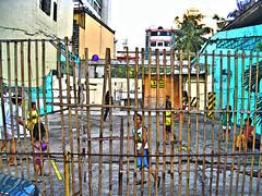BALL GAME - MANILA_2007_ID HEARN MACKINNON (ID Hearn Mackinnon) Tags: manilaphilippines manila makati kids children playing game ball poverty pinoy filipino 2007 idhearnmackinnon