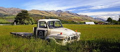 An attractive old car (AtomicZen : )) Tags: old trip travel summer vacation sky cloud mountain mountains tourism nature beautiful car clouds spectacular landscape outdoors island ancient scenery view farm south scenic southern zealand journey damage