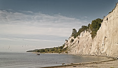 Bluffs, mid-morning (StephenCaissiePhoto) Tags: trees sky toronto beach birds clouds sandstone rocks quiet gulls shoreline sunny calm cliffs scarborough serene lakeontario midmorning drainagepipe