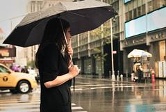 Umbrella in the Rain with Girl (Ed Lam) Tags: street leica city nyc newyorkcity people urban newyork girl rain umbrella 35mm bokeh manhattan voigtlander streetphotography rangefinder m8 cosinavoigtlander edwardlam leicam8 edlam