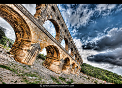 Pont du Gard Roman Survival (Edwinjones) Tags: voyage old trip travel bridge blue sky france art heritage history classic nature colors architecture clouds photoshop river photography photo europe raw arch foto photographie angle image artistic roman sony culture engineering sigma arches du unesco worldheritagesite aqueduct pont provence dslr monuments nimes pontdugard avignon southoffrance hdr romanempire gard preservation worldheritage topaz photomatix a700 sigmawideangle aquedc