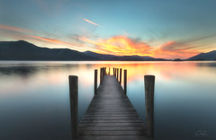 Ashness-Pier (Paul Clark Images) Tags: ashnesspier blue borrowdale clouds cumbria derwentwater england greatbritain hills jetty lake lakedistrict landscape longexposure mountain orange pier reflection sky sunset uk water waterscape wood yellow