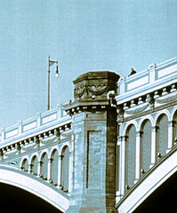 Jumper on North Bridge_circa 2006 (andronicusmax) Tags: handle handlewithcare pressure polis polizia polizei popo cop calminginfluence talk negotiation crisismanagement contemplate deepinthought contemplating loneliness lonely despair sadness detail selfdestruct danger muted tension colorfilter colourfilter choices profoundchoice deep discussion talking letstalk stone support strut trainstation waverley classicalarchitecture attempt dramatic drama police depression death jumper suicide northbridge edinburgh film 35mm ilford