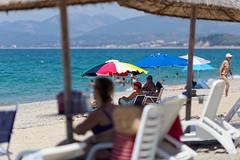 In the beach: Talking with friends (bbarekas) Tags: people talking swimming parasols sunbeds sand beach crowd waves sea sun sunnyday monolithi preveza epirus greece