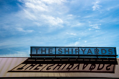 The Shipyards. (Jason Gallant.) Tags: blue roof light summer sky lines vancouver clouds canon eos words shadows bright letters northshore lonsdalequay 60d shipayrds