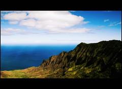 Na Pali Coast (Doubletee) Tags: ocean blue sky green water clouds geotagged hawaii kitlens cliffs pacificocean valley kauai kalalauvalley pali napalicoast cinemascope puuokilalookout canonefs1855mmf3556 kokeestatepark