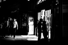 Hello.-Goodbye. (walkdontthink) Tags: street blackandwhite white black streets monochrome silhouette bristol photography kissing couple streetphotography panasonic trainstation compact 43 clinch gf2 micro43