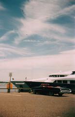 Sag Harbor, NY (Ellis Mitchell) Tags: nyc sea sky usa ny newyork colour ford film clouds america 35mm boat kodak detroit convertible mini dust carpark sagharbor hanimex drophead