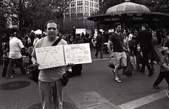 the privilege pyramid (Pine Ear) Tags: leica nyc bw film 35mm kodak manhattan f14 voigtlander trix protest 400tx 1600 demonstration processing push gothamist unionsquare m6 nokton occupy