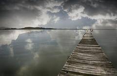 Lake Trasimeno, Italy (sreesephoto) Tags: italy lake trasimeno dock clouds water flag