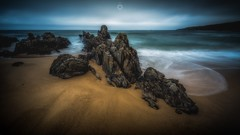 Clinging to the Sand (Augmented Reality Images (Getty Contributor)) Tags: canon clouds coastline landscapesunnysidebeach leefilters longexposure morayshire rocks sand scotland seascape tide water waves