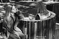 pensive pose (Dean Forbes) Tags: seattle pioneersquare girl pensive bw candid seated sitting