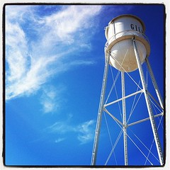 Gilbert Water Tower (Lainey1) Tags: blue arizona sky tower water clouds square watertower lofi squareformat gilbert thefarmersmarket thewatertower iphoneography instagramapp uploaded:by=instagram foursquare:venue=4bac2443f964a520d1e63ae3