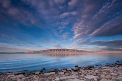 Partly Cloudy (Adam's Attempt (at a good photo)) Tags: blue sky mountains reflection water rock clouds sunrise utah moss nikon rocks cloudy wideangle utahlake partlycloudy utahcounty d90 lr4 americanforkut americanforkboatharbor utahlakesunrise 9202012