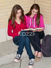 teenage girls reading a book together (elisapeople2012) Tags: friends girl beautiful beauty modern female bag reading book togetherness concentration student education pretty sitting friendship fulllength teenagers learning companion studying twopeople casualwear preparations bonding teamwork caucasian schoolbag companionship youthculture casualclothing universitystudent 1617years teenagersonly legscrossedatknee onlygirls personineducation secondaryschoolchild teenagegirlsonly personinfurthereducation
