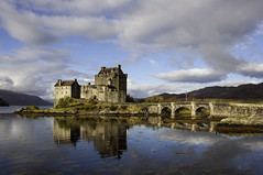 Eilean Donan Castle (Keartona) Tags: uk morning bridge blue sky building castle water clouds reflections scotland highlands eilean donan