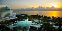 Fontainebleau (rodvelt) Tags: ocean sea usa beach pool sunrise canon palms geotagged dawn hotel florida miami 5d magichour fontainebleau markiii 24105mm