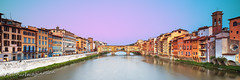 Ponte Vecchio (Garry - www.visionandimagination.com) Tags: city bridge italy reflection horizontal architecture river outdoors photography florence cityscape dusk nopeople medieval illuminated ponte tuscany firenze arno toscana medici pontevecchio worldheritage arnoriver archbridge stonearchbridge traveldestinations buildingexterior internationallandmark highangleview italianculture vasarianocorridor pontidifirenze keywordsbuiltstructure