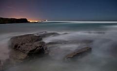 Al fondo Santander..... (Manuel Lpez Frias) Tags: sea moon beach night marina noche mar playa luna nocturna seda santander rocas largaexposicion resplandor galizano