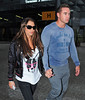 Katie Price and new husband Kieran Hayler arrive at Heathrow airport after flying back from their honeymoon