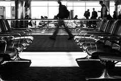 A Step Frozen in Time 32/365 (Ashurii Aren) Tags: blackandwhite bw motion blur 50mm airport dof chairs dia denverinternationalairport photoaday 365 project365 32365 nikond5000 3652013 365the2013edition