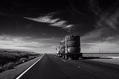 Click_This_TAPG_Big_tires_open_road (jnspet) Tags: bigtires truck interstate5 highway tire california monochrome blackandwhite blackwhite bw bigsky clouds road
