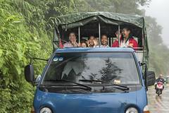Happy girls (tmeallen) Tags: girls happy waving rainyday mists reflections pickuptruck backoftruck trees road sapa laocai marketday vietnam borderregions culture travel