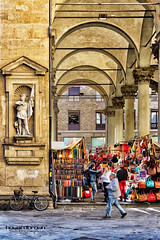 Souvenir in Italian leather? (Howard Brown Photographic) Tags: firenze florence italy italia italian market piazza del mercato nuovo hdr street urban shopping shoppers man walk cobblestone archway arch architecture statue sculpture bike bycle