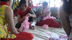 Doll Making Class (www.WeAreHum.org) Tags: textile nepal thread bobbins gandhi tulsi ashram school for women kathmandu sowing weaving winds threads mechanical loom wood shuttles feet arts