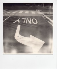 only (::jmo::) Tags: impossible sx70 polaroid blackandwhite road arrow bent sigh