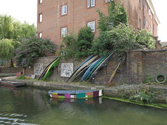 arty boat (squeezemonkey) Tags: london canal regentscanal grandunioncanal waterway laburnumbasin boats canoes rowingboat painted decorated
