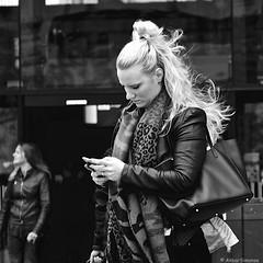 DSCN2199 (Akbar Simonse) Tags: dscn2199 holland netherlands nederland people candid girl cellphone smartphone mobilephone mobieltje streetphotography straatfotografie akbarsimonse vierkant square zwartwit bw blancoynegro bn monochrome haar blonde blond rotterdam rotjeknor roffa hair leather shawl
