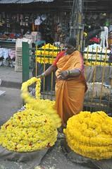 DSC_1438 (rajashekarhk) Tags: ganeshachaturthi vinayakachathurthy yeshwanthpur yeshwanthpurmarket flowerseller flowervender festival colorcolour yellow sales selling street roadsidemarket bengaluru karnataka womenselling