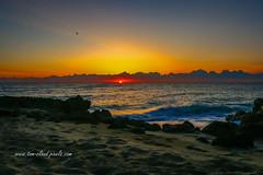 Red Glow Sunrise (tclaud2002) Tags: sun sunrise dawn morning horizon clouds cloudy rocks beach atlantic ocean sea atlanticocean seascape outdoors outside usa