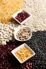 assorted beans on a bowl (oolafood8877) Tags: red food orange brown white abstract black detail macro green texture nature yellow closeup cuisine beans healthy mix colorful raw pattern natural lima eating many group cereal diversity dry selection nobody vegetable collection whitebackground butter pile ingredients peas backdrop organic choice variety beluga multicolored common pea runner edible heap assortment variation isolated assorted legume lentils legumes nutrition sorted nutritious chickpea uncooked mung dehydrated dietary