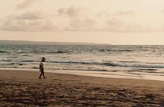 Walking on Pantai Berawa (ebiara) Tags: ocean trip travel sunset sea bali beach canon indonesia asia waves pantai kuta 2010 seminyak berawa