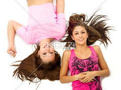 teenage girls lying against white background (peopletuff2012) Tags: friends portrait cute beautiful smiling happy photography togetherness pretty friendship longhair happiness indoors whitebackground leisure studioshot resting cheerful mate freetime relaxation lying relaxed companion sidebyside twopeople bonding caucasian sparetime tousledhair teenagegirls toothysmile colorimage lookingatcamera 1617years teenagersonly lyingonback directlyabove humanrelation