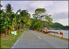 The other side of Cebu (pickled_newt) Tags: road island fiesta village place philippines western cebu visayas coasta barangay