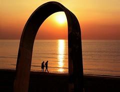 Traguardi di coppia (meghimeg) Tags: sea sun love beach water sunrise walking couple mare arch alba loveland sole acqua arco amore spiaggia 2012 coppia passeggiata