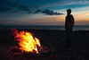 Fire (TGKW) Tags: boy sunset portrait sky people man beach silhouette clouds standing fire flame shore ayr kenny prestwick 6987