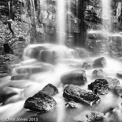Kimmeridge Waterfall 2 Black & White. (Chris Jones www.chrisjonesphotographer.uk) Tags: chris england blackandwhite bw white black west fall beach water face rain flow bay jones waterfall movement rocks south down boulder rockface falling dorset flowing cascade steep kimmeridge fock sheer downwards rainwater