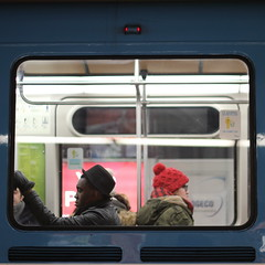 black hat, red toque, winter commute (sonyacita) Tags: square metro montreal hats commuters