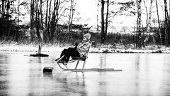 Brooming Fun (dennisdasfoto) Tags: winter boy blackandwhite bw ice barn is blackwhite vinter kid child sweden schweden streetphotography kind sverige sled spark junge slde svartvitt pojke schwarzweis kicksled sparksttting klke gatufotografi strasenfotografie tretschlitten dt50mmf18sam